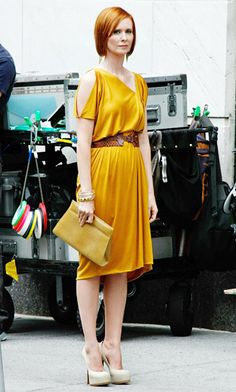 SATC. Cynthia Nixon's Miranda turned heads in a marigold belted frock with a Kara Ross AMO lizard clutch.