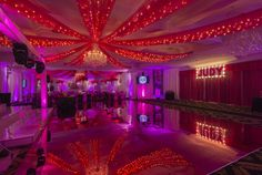 The walls and ceiling were #draped with beautiful sheer #pink fabric, which was reflected in the pink mirrored dance floor!  The glitz, #glam and thrill of #Hollywood came to life for one special Bat Mitzvah girl.  It was an incredible night in Westchester for Judy to be the celebrity of the #party!  Designed by @xquisiteflowers  #eventdecor #BatMitzvah #sweet16 #VIP #party #partyideas #hollywoodtheme