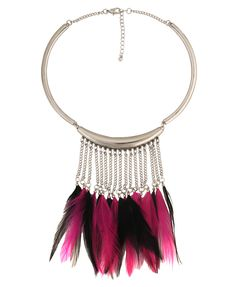 A high polished necklace featuring three structured pieces and a chain back. Chain fringe with contrast feather ends. Lobster claw clasp. Lightweight.