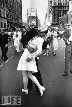 """The Kiss: Photo by Alfred Eisenstaedt, 1945. """"The"""" photo taken on V-J Day. Eisenstaedt never got their names, but they are famous nonetheless."""