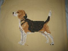 I was sorting through an old cross stitch bin yesterday and came across a whole pile of finished projects (and 4 unfinished ones) I'd completely forgotten about. This little beagle was completed in 1996.