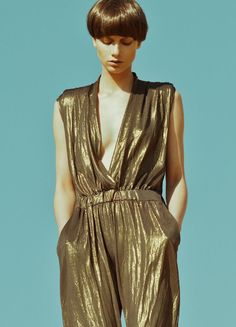 metallic gold, jumpsuit, cinched, bowl cut, deep v Gold Fashion, 70s Fashion, Latest Fashion Clothes, Vintage Fashion, Roxy, Gold Jumpsuit, Metallic Jumpsuits, Edgy Chic, Style Deco