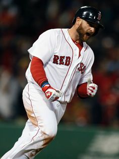 BOSTON, MA - APRIL 20: Jonny Gomes #5 of the Boston Red Sox reacts after hitting a three-run home run in the sixth inning against the Baltimore Orioles at Fenway.