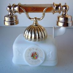 My mom had this Avon french telephone perfume bottle on her dresser and we'd use it when playing house.