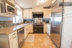Ink Property - Our Los Angeles, Valley Glenn MAIN HOUSE Vacation Rental has the kitchen you dream of!  A Viking Appliance lovers Paradise.  It just so happens, it is also BEAUTIFULLY SPACIOUS & has a year round HEATED POOL... Ah, the luxuries of life.