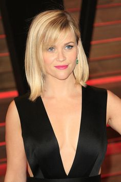To get a style like Reese Witherspoon's piecy side bangs, ask to have your bangs a little shorter on one side of the face and then subtly blended across the forehead to the other side. Scuoppo says the shorter bangs will help guide the longer ones to the side.