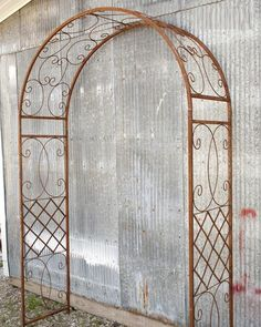 "Wrought Iron Scroll Arbor Garden Art Back Yard Trellis - Metal Arch   This wrought iron arbor has an attractive design and will add style to your garden or entry way. 57"" wide x 90"" tall x 20"" front to back."