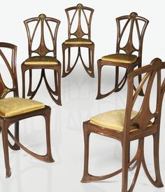 Louis Majorelle A SET OF FIVE MAHOGANY AND GILT-BRONZE CHAIRS WITH ORIGINAL VELVET UPHOLSTERY, CIRCA 1905