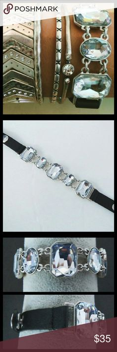 """""""Shining Delight""""- Crystal Drops Snap Bracelet Is the sun shining brighter, or did this rhinestone bracelet just illuminate your whole world? A genuine black leather band, aligned with sparkling glass crystal stones and genuine matte silver plating, make this luxe accessory so glam, you?ll need shades! Romance, vibrance, and effortlessness translucent color... A statement piece full-of-character that promises to become an instant classic for your everyday ensembles!                 ??In…"""