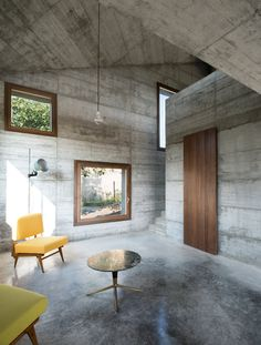 House R by 35a Studio is a concrete holiday home with a pointed roof