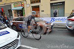 The team Sky rider racing through the narrow streets of Alicante during the 2017 La Vuelta Valencia.
