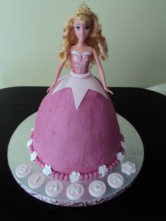 Princess Aurora Birthday Cake.  White Chocolate Cake, with raspberry buttercream, fondant accents, royal icing flowers, and a real Aurora doll.