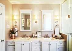 dual mirrors and towel rings, sconces in between