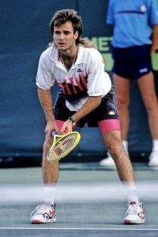 """1990s Andre Agassi's neon ensembles, signature mullet, and """"Image is Everything"""" ad campaign defined a decade of tennis style."""
