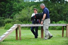 Trainer Mike working with Anita and K-9 Dazzy, dog trainer, agility dog trainer