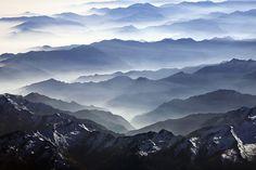 Davos, Switzerland. Mist over mountains, wanderlust.