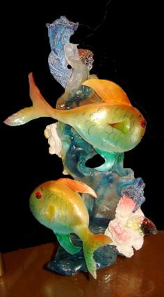 """Marine Reef Sugar Sculpture - nilsrowland.com  """"I created this underwater scene using many different techniques. Pulled, cast, rock, blown, and baked sugar techniques were used to give the piece depth and movement.  To finish, the fish were air brushed to create life-like colors that fade into one another."""""""