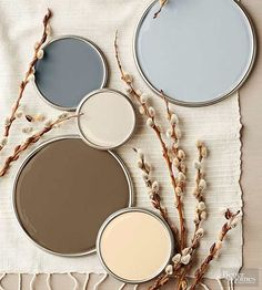 Although this stony-tone palette's charcoal and ash grays read as cool, reddish undertones heat up the cocoa brown, cream, and khaki hues to create a perfectly balanced mix of warm and cold temperatures. Try this palette in rooms outfitted with naturally warm-stained cabinets, flooring, and furniture.