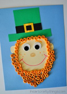 Leprechaun Kids Craft, St. Patrick's Day Craft for Kids | Make a beard out of orange Fruity Cheerios Cereal | from iheartcraftythings.com