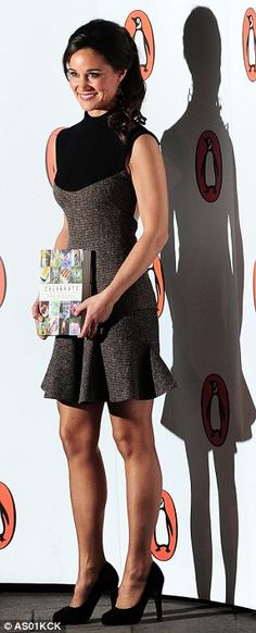 Pippa Middleton is pictured holding her new book this evening