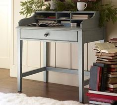 Jacqueline Bedside Table #potterybarn.  Great idea combining this desk with the shelf behind - looks attached together at first glance.