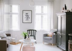 @ decor8. Love this small living room. The wardrobe in the room is a good idea for small houses with little tall storage.