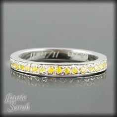 A mother ring - a band with your kids birth stone. A band for each child