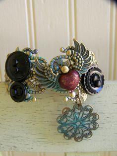 Vintage Altered  Button Bracelet Filigree Bracelet Vintage Ornate Charm Bracelet Cuff Bracelet. $34.00, via Etsy.