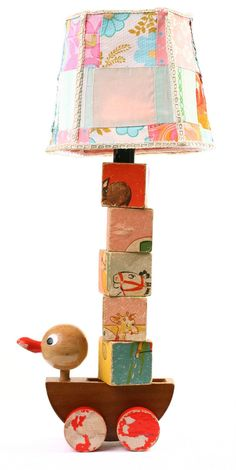 Lamp made with a vintage pull toy, old blocks and an upcycled lamp shade. ♥