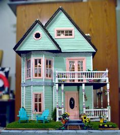 A winner of the 1st annual Undersized Urbanite dollhouse contest. Love the curb appeal!