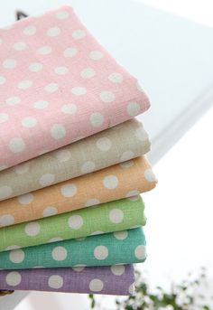 A Yard of one color, Polka Dots on lovely colour Linen, U2680. $16.00, via Etsy.