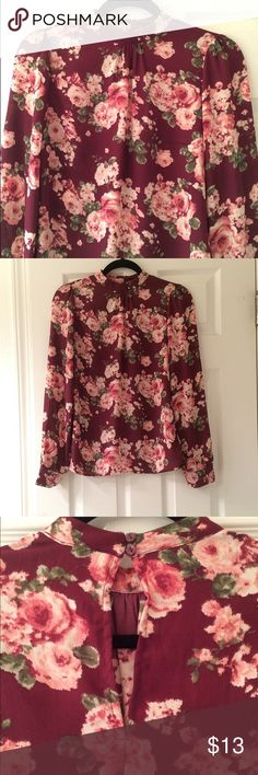 burgundy floral blouse burgundy high neck long sleeve blouse with floral print. from forever 21. size small. snaps around the neck in the back. perfect condition Forever 21 Tops Blouses