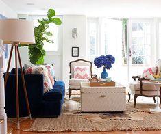 We love the blue sofa in this trendy living room! More living room designs: http://www.bhg.com/rooms/living-room/room-arranging/living-room-designs/?socsrc=bhgpin082313bluesofa=5