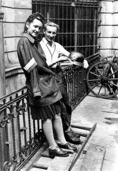 "Polish insurgents Bożena Grabowska (codename: ""Magda"") and Cpl. Cadet Antoni Tuleja (codename: ""Niedźwiedź""), both of ""Koszta"" Company of the Armia Krajowa (Home Army) resistance movement pose for a photograph at Moniuszko 11 Street in the city...pin by Paolo Marzioli"
