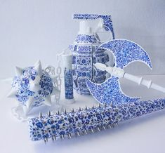 in the delft blue style of ceramics, artist helena hauss has sculpted and hand painted a series of highly unconventional 'weapons'. Delft, Sculptures Céramiques, Ceramic Sculptures, Pen Design, Mixed Media Artists, Ceramic Painting, Painting Art, Ceramic Art, Hand Painted Ceramics