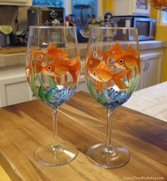 https://www.etsy.com/listing/263625012/hand-painted-goldfish-wine-glass-gold?ref=shop_home_active_3