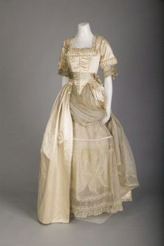 Lucile wedding dress; Silk satin, lace, silk flowers, 1918. Chicago History Museum.