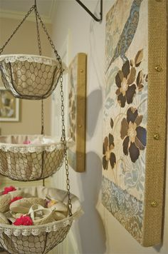 Use a hanging produce basket to corral small baby items.