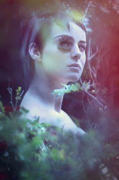 Photography - Jena Rose  Make-up - Jessica Blease  #locationshoot #feathers #leaves #bushes #flowers #undergrowth #creative