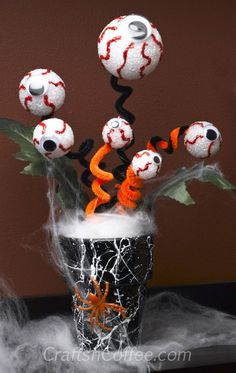 Creepy Halloween crafts if you add green styrofoam balls and pipe cleaners instead, you could have little shop of horrors plants!
