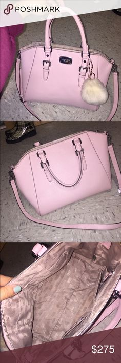 Baby Pink Michael Kors Leather Crossbody Tote Gorgeous baby pink Michael kors Tote, with a Crossbody strap. Very roomy purse, and such a gorgeous color. It has been used very gently, and very rarely!! The front metal logo has some light scratches, as well as the feet on the bottom but it is nothing big or noticeable. Only other flaw I could find is an extremely small light stain on the bottom of the bag (shown in the fourth photo, on the top right). (Probably can come out!) ***PUFF KEYCHAIN…