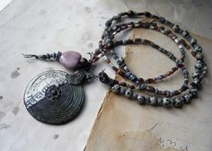 Beaded Necklace -- Stone, Glass, Bone Beads - Assemblage Pendant - Rustic Beaded Necklace. $62.00, via Etsy.