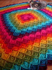 Crocheted in the round from the center out. No gauge or yardage given.