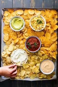 Chips and dip is the perfect, easy snack for entertaining a crowd. Make a variety of dips, add all your favorite chips and serve on a big platter. snacks for a party Chips and dip platter - Simply Delicious Charcuterie Recipes, Charcuterie Board, Party Food Platters, Snack Platter, Snacks Für Party, Party Food Bars, Parties Food, Party Party, Keto Snacks