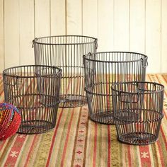WIREWORK BASKETS, SET OF 4 -- Vintage iron coils suggested the shape of our hefty iron wire baskets, each equipped with double handles—for toys and games, magazines, firewood, even recycling. Imported. Catalog exclusive. Set of 4