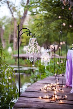 Simple and perfect for outdoor receptions- hanging chandeliers and strung lights. Photo by Randy Coleman Photography. www.wedsociety.com #wedding #lighting