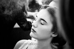 young woman during makeup. black and white photography.