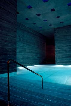 """vanished: """" Therme Vals is the hotel/spa complex in Vals, built over the only thermal springs in the Graubünden canton in Switzerland. Created by Swish architect Peter Zumthor. This photograph was. Indoor Pools, Swiss Architecture, Architecture Design, Architecture Student, Therme Vals, Living Spaces Furniture, Space Furniture, Living Rooms, Peter Zumthor"""