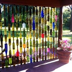 Colorful outdoor screen made from glass bottles
