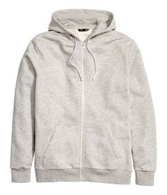 Light gray melange. Jacket in sweatshirt fabric with a lined, drawstring hood…